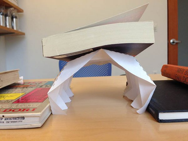 paper holding book