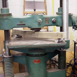 a press, deforming a length of metal
